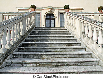 imposing stone steps leading to the entrance of the...