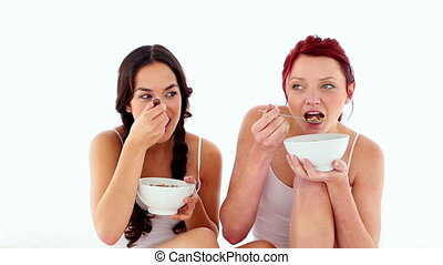 Gorgeous young women eating cereal - Gorgeous young women...