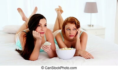 Attractive bored women watching tv - Attractive bored women...