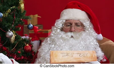 Christmas Lantern - Santa reading a letter by the light of a...