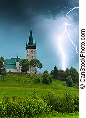 Storm with lightning in old village church in Spišský...