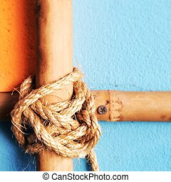 Cross bamboo bars with rope tied on