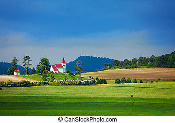 Rural landscape in Slovakia - Tiny beautiful church with red...