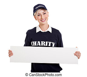 young charity worker holding blank white board - friendly...