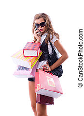 Close-up of happy young woman on a shopping spree. Talking...
