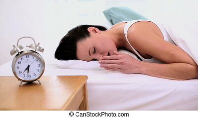 Tired woman napping - Beautiful tired woman napping in her...
