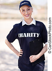 charity volunteer - pretty charity volunteer on street...