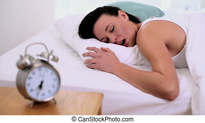 Young woman napping - Cute young woman napping lying in her...