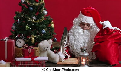 Getting Ready For Christmas - Santa Claus putting presents...