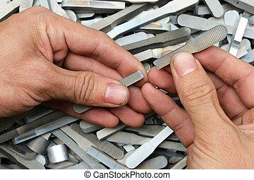 Show result after test - Hand show broken tensile test bar...