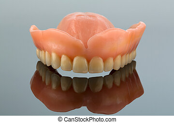 dentition with reflection - teeth, symbol photo for...