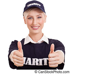female volunteer with thumbs up