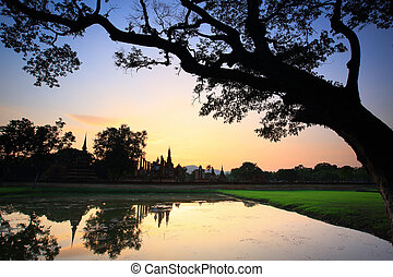 Sukhothai - Buddha in the sunlight in the evening at Wat...