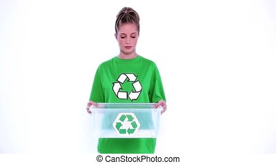 Desperate environmental activist showing a plastic box on...