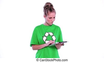 Lovely environmental activist using thoughtful her tablet on...