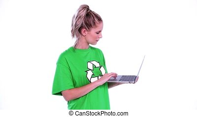 Young blonde environmental activist using her notebook on...