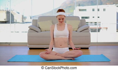 Content calm woman meditating in he
