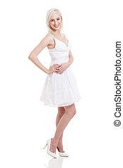 blonde woman posing in a beautiful white dress