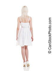 rear view of young blonde woman in white dress