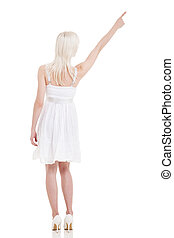 back view of young European woman pointing up
