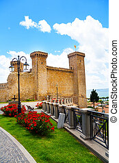Bolsena castle and flower beds - Bolsena castle and square...