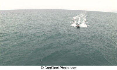 People atop a Riva motor boat - People atop a fancy Riva...