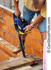 construction worker on a job site - a single-family house is...