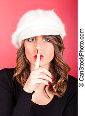 Silence Gesture - Woman with finger near lips asking the...