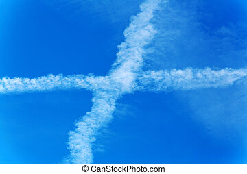 contrails of aircraft against blue sky. pollutants and co2...