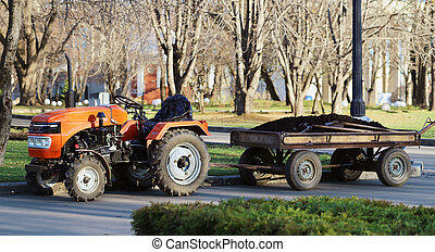 Orange tractor with a trailer park
