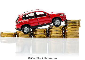 costs of a car. symbol photo with car and coins