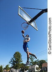 Basketball Player Dunking - Young basketball player drives...