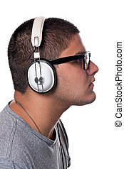 Teen Listening to Music - A young man listens to music with...