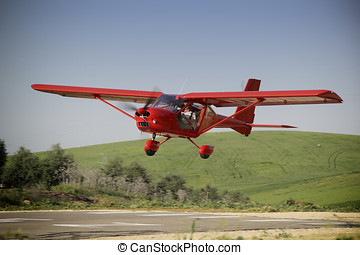 Red plane manned by student and teacher of a class flight...