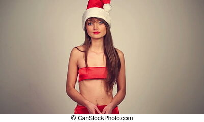 Christmas girl with shopping bag - Sexy girl in santa claus...