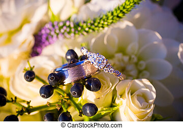 Wedding Rings and Flowers - Wedding rings of the bride and...