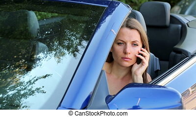 Girl with a phone in a cabriolet