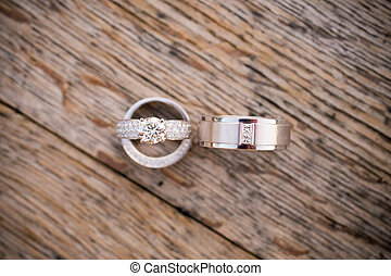 Wedding Rings on Wood - Wedding rings are placed on a wooden...