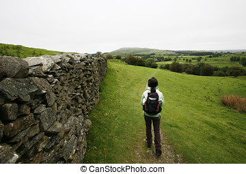 Woman hiking in Lake District - An East Asian Woman, walking...