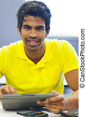 male university student using tablet computer - handsome...