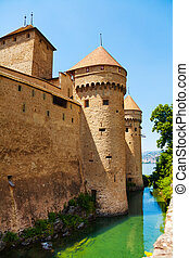 Chillon castle walls and towers and Geneva lake waters