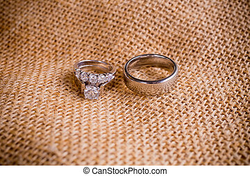Wedding Rings and Burlap Sack - A burlap sack cloth is used...