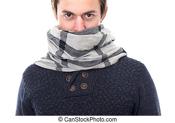 Portrait of a male fashion model with scarf covering face