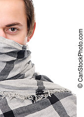 Half face portrait of a male fashion model with scarf covering face