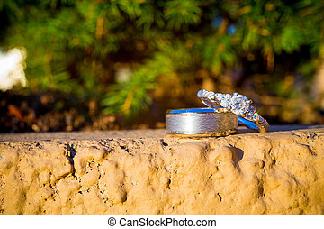 Wedding Rings Outdoor Concrete - An outdoor closeup...