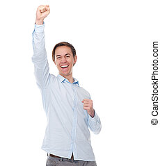 Portrait of a happy cheerful man with arms raised in celebration