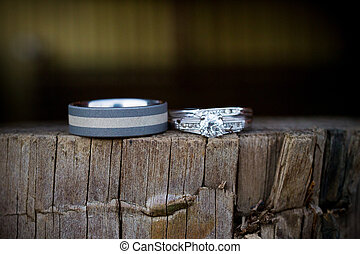 Wedding Rings on Wooden Wall - A wooden wall post is used to...