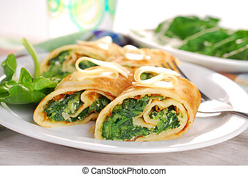rolled spinach pancakes cut into small pieces - rolled...
