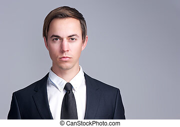 Close up portrait of a serious business man face isolated on...