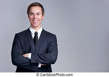 Close up portrait of a relaxed business man smiling with arms crossed